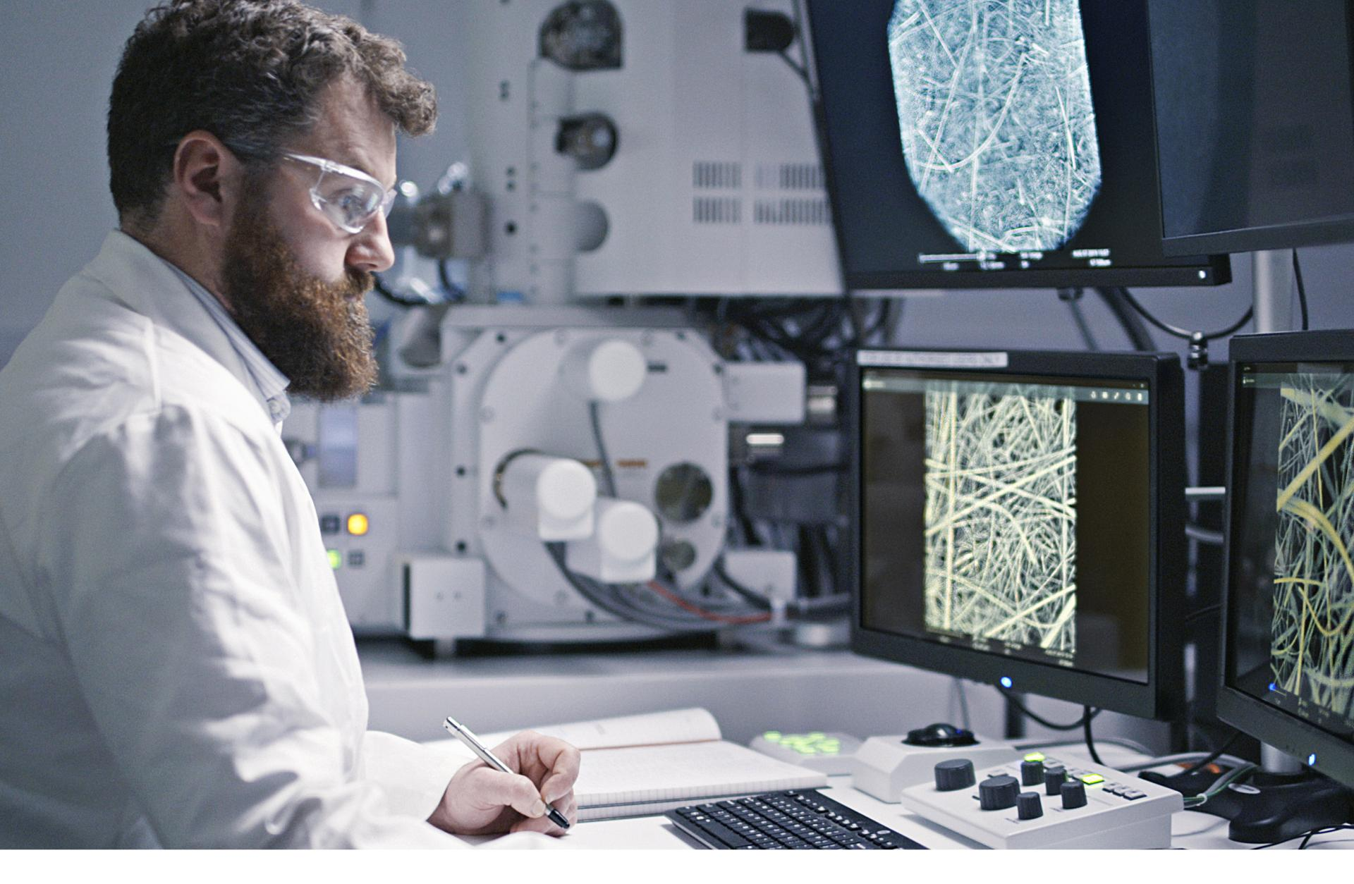 A scientist studying fibres on computer screens