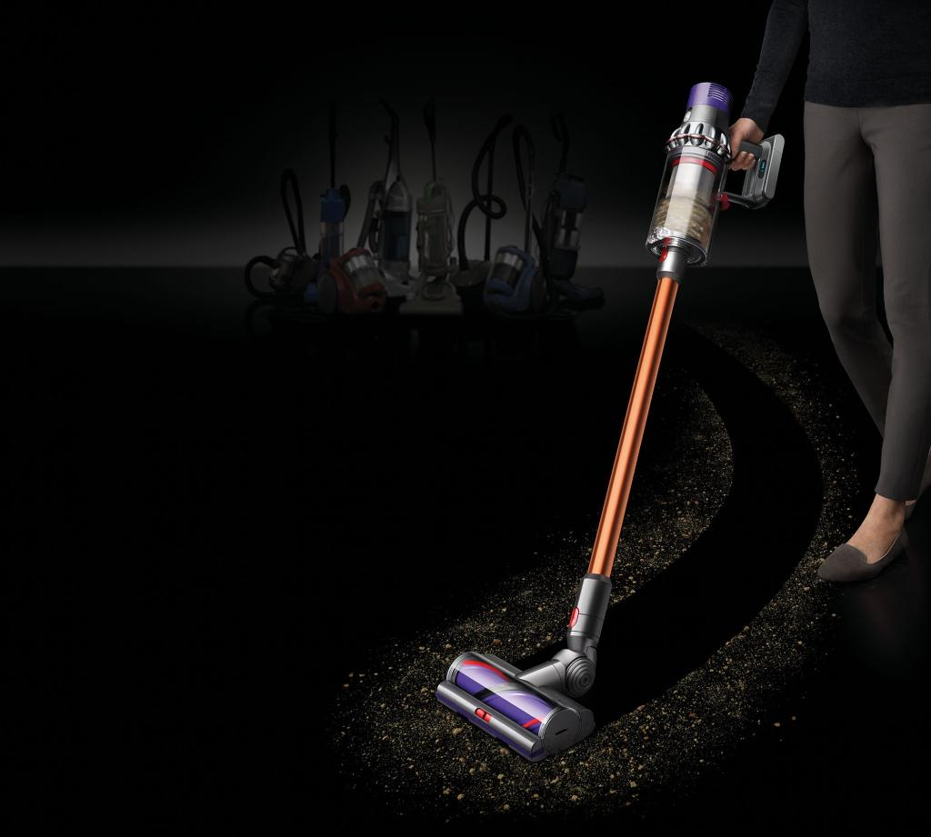 Dyson V10 vacuum on black surface