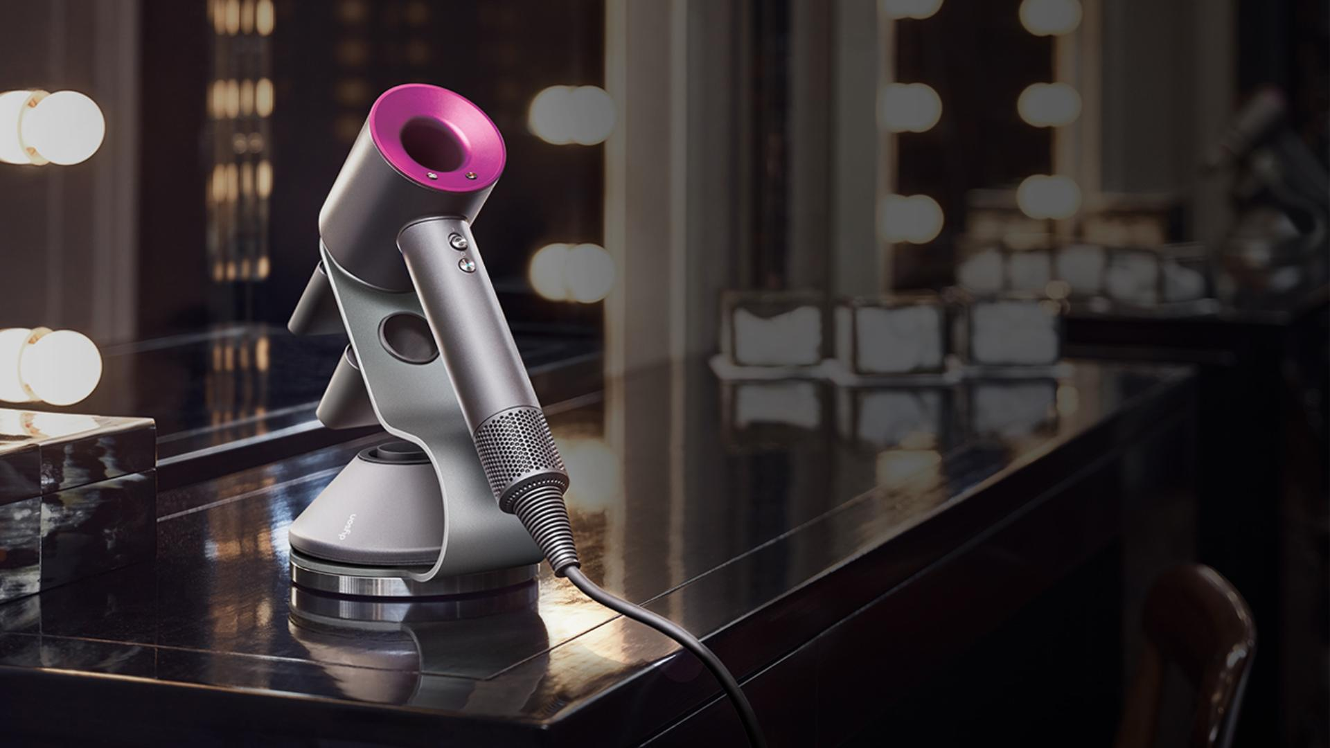 Dyson Supersonic hair dryer on a desk in a hotel room