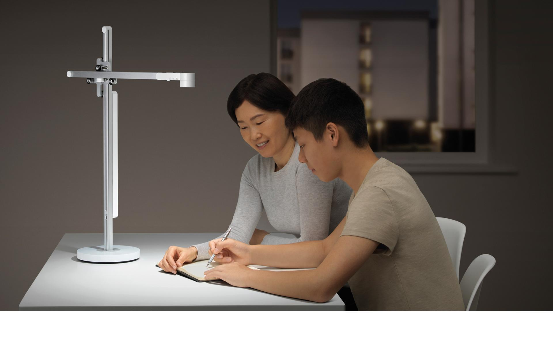 Mother and son studying under Dyson Lightcycle