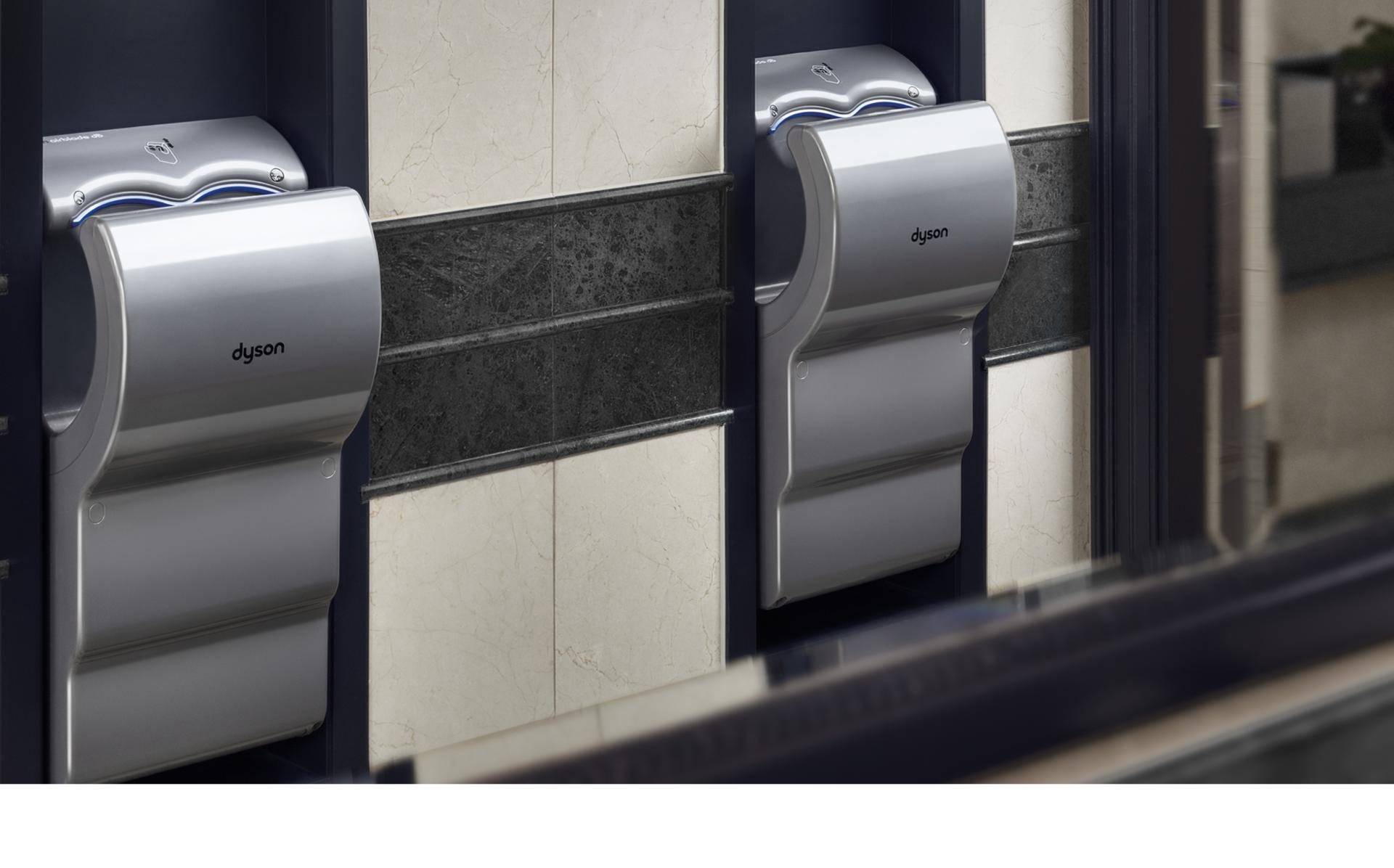 Two Dyson Airblade dB hand dryers in hotel bathroom