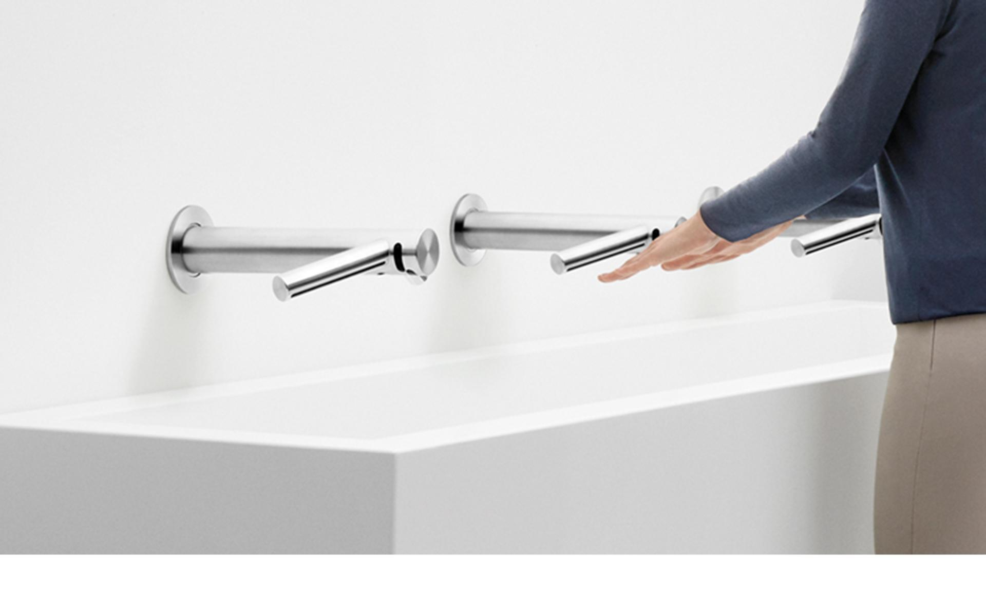 Drying hands at the Dyson Airblade Wash+Dry