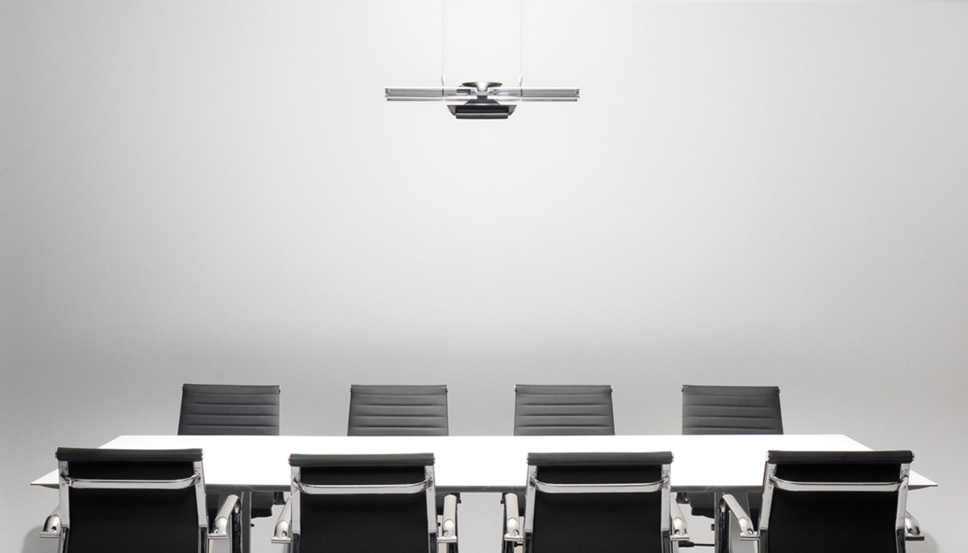 Dyson Cu-beam duo light over desk and chairs.