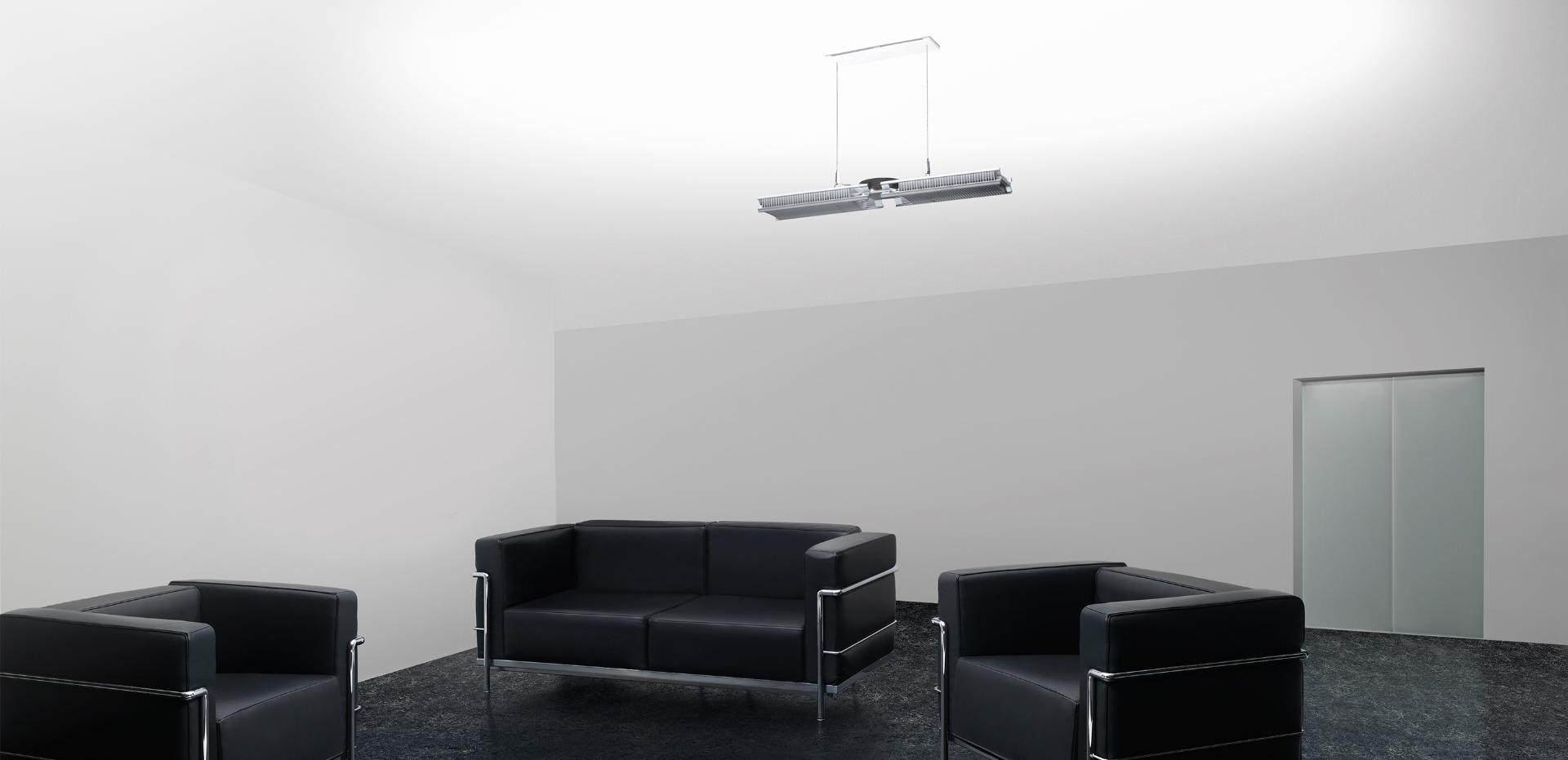 Dyson Cu-Beam Up light above sofas in an office lobby
