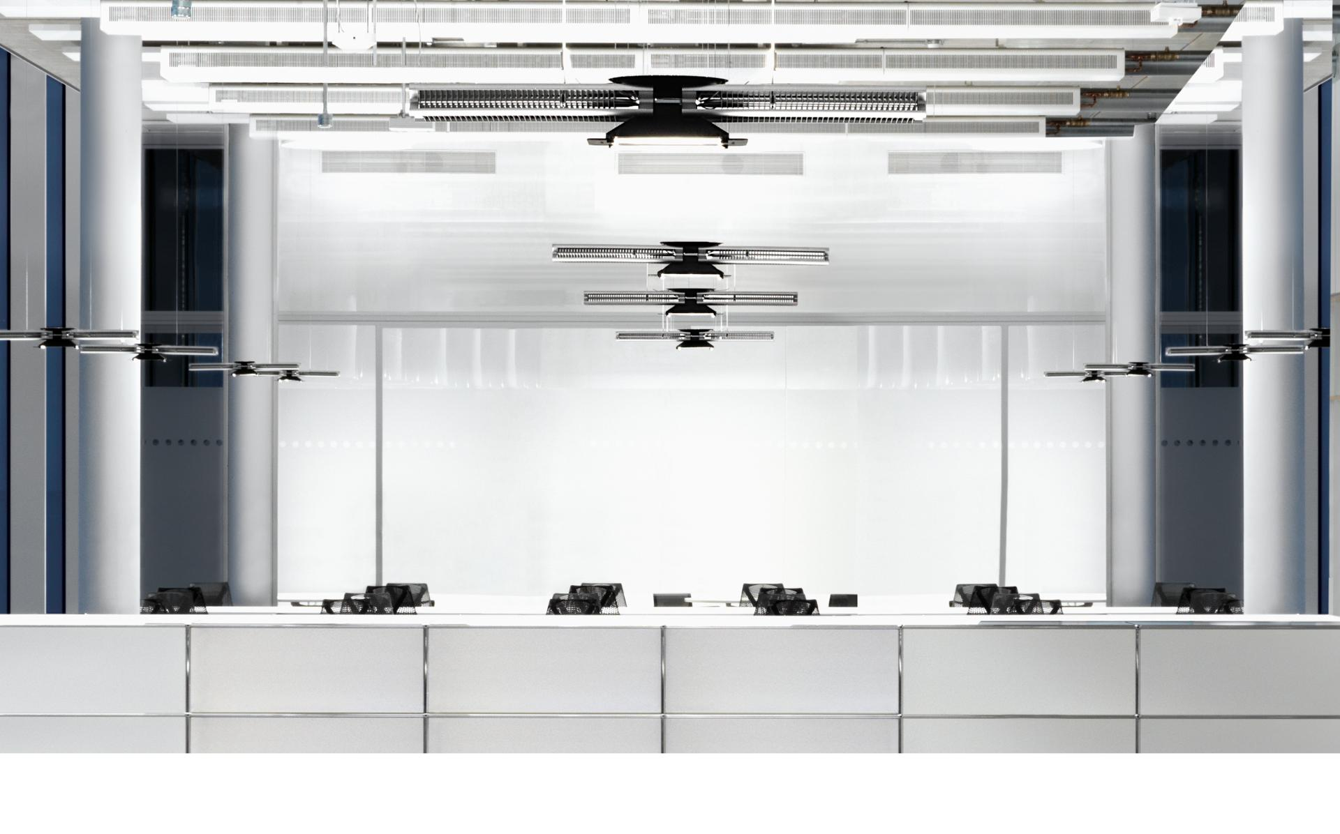 Dyson lights hanging over office desks