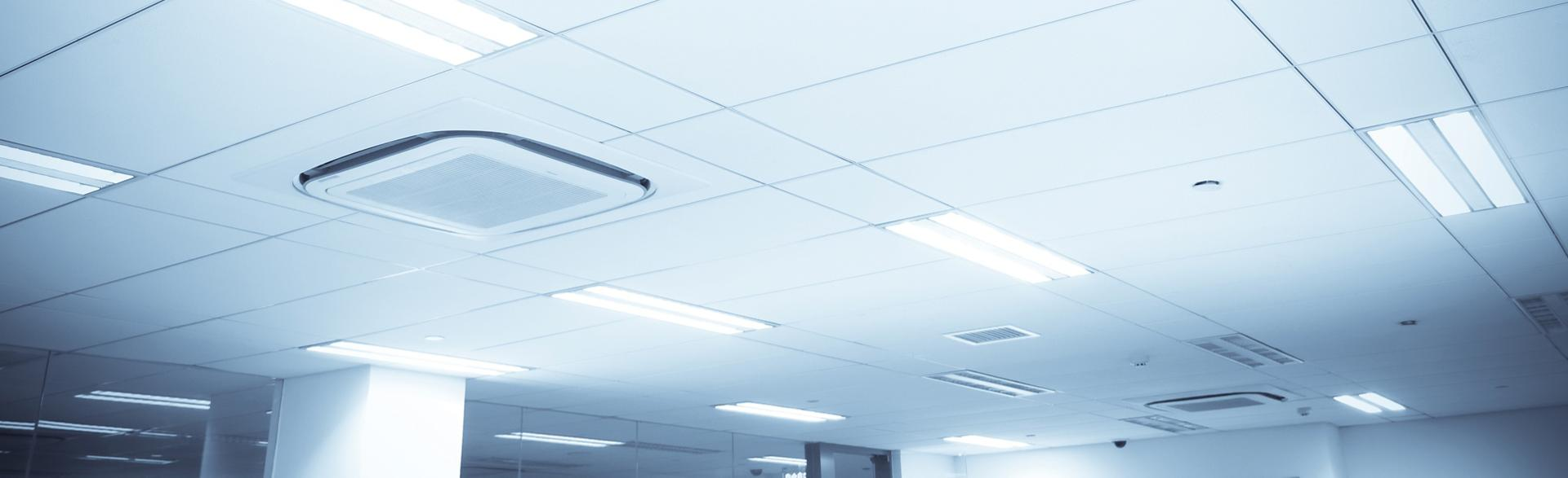 Inefficient, costly fluorescent bulbs on office ceiling