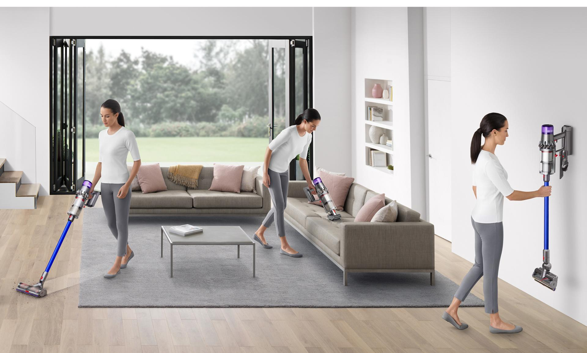 Three women using the Dyson V11 around living space