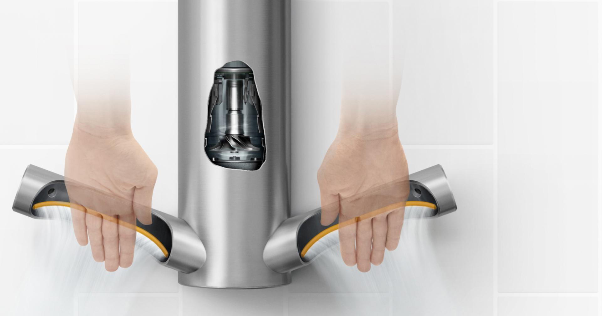 Model standing next to Dyson Airblade 9kJ hand dryer
