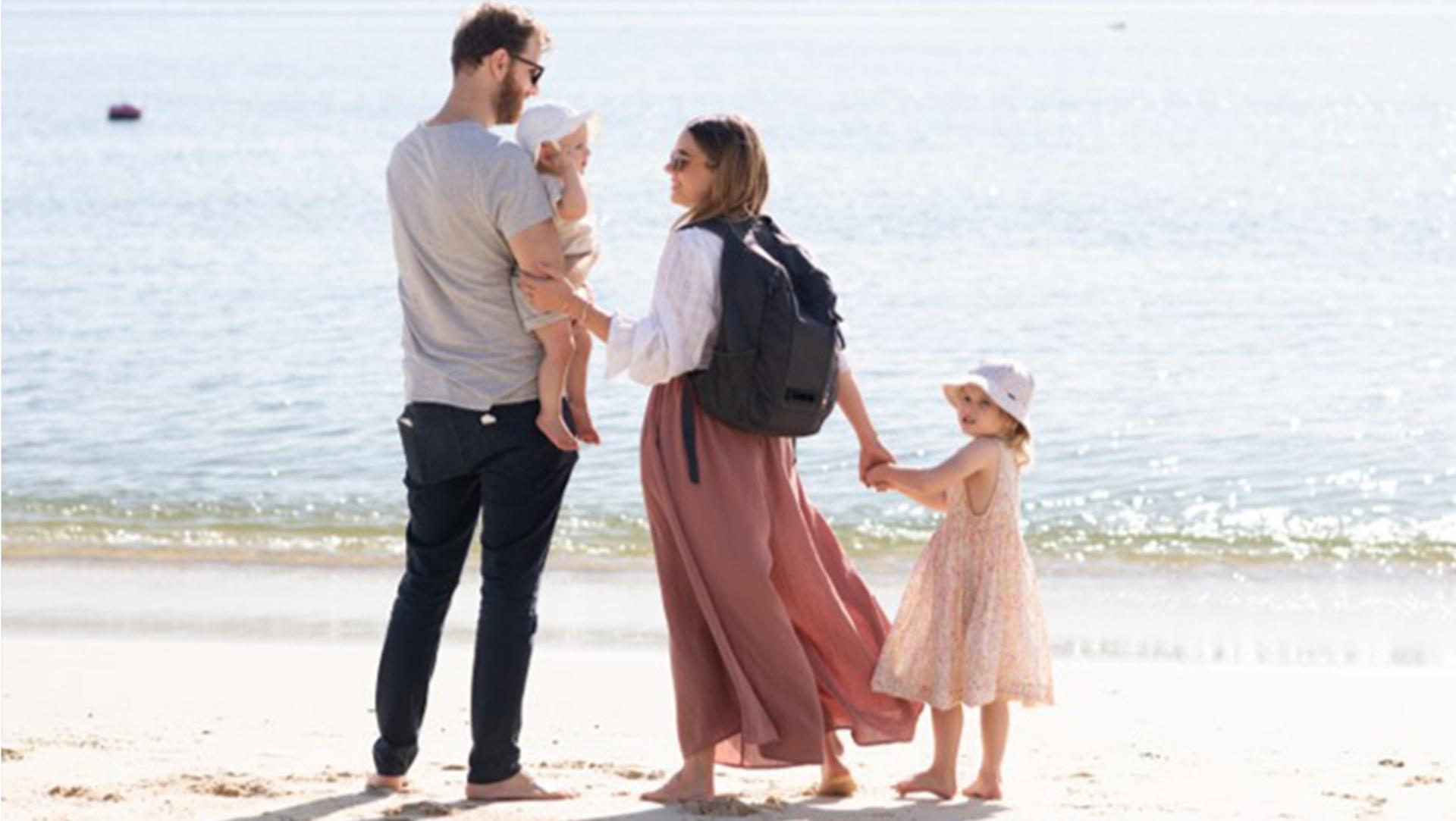 Leah family on beach with Dyson backpack
