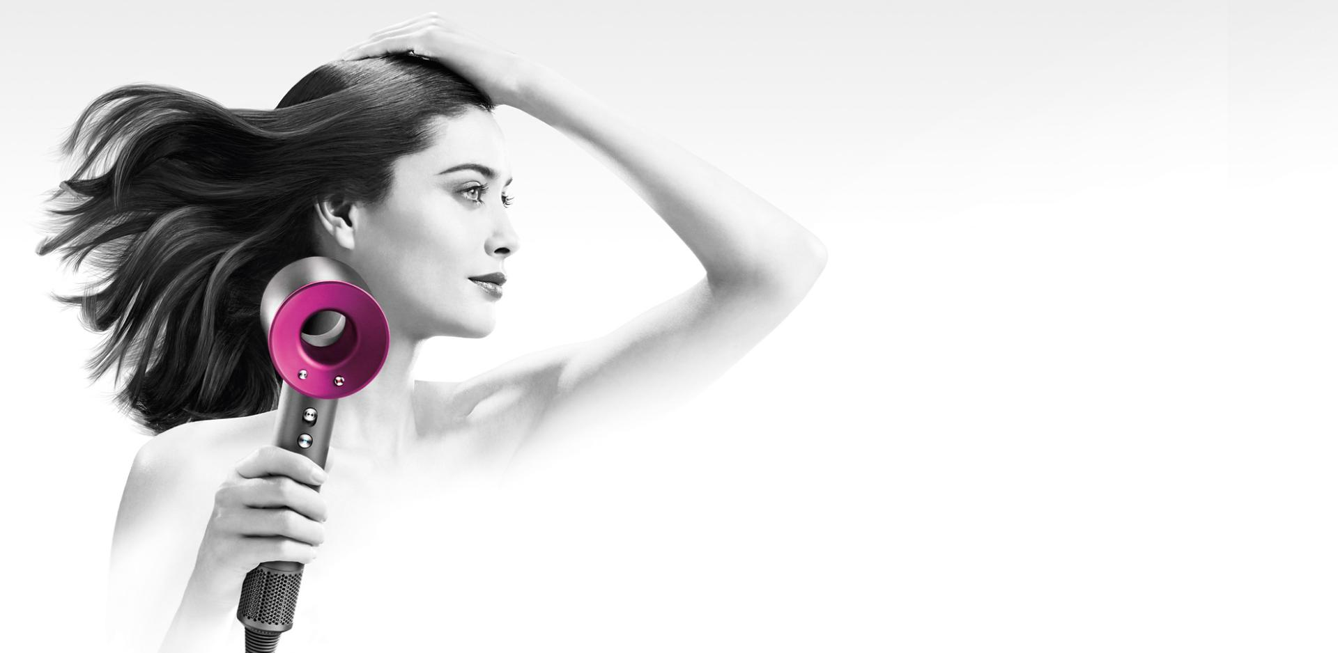 Model with Dyson Supersonic™ hair dryer