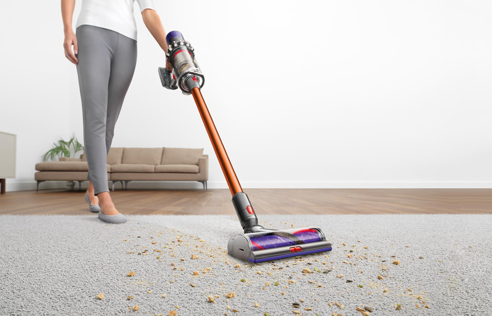 Dyson cyclone v10 being used on flooring