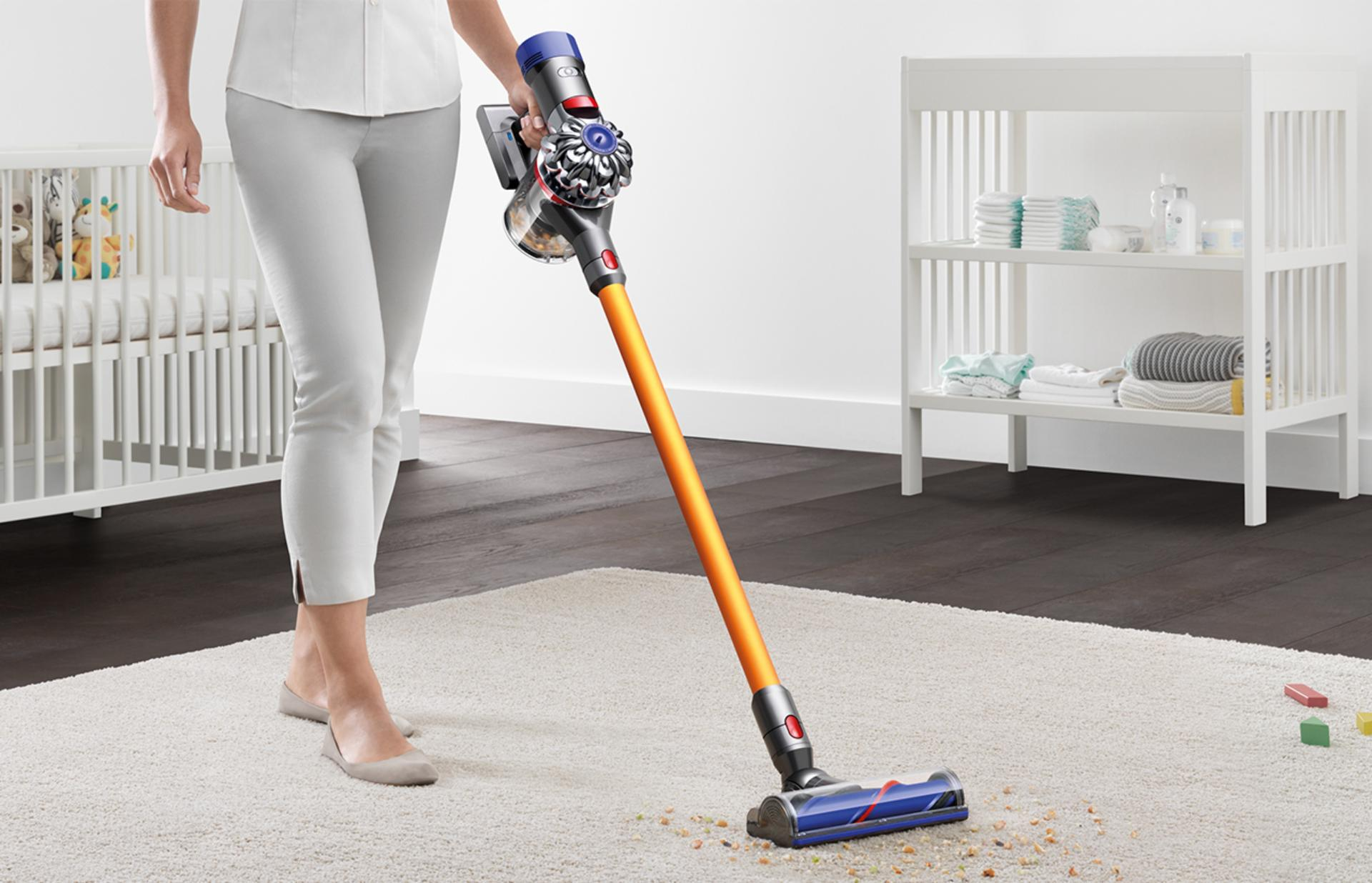 Dyson v8 being used on flooring