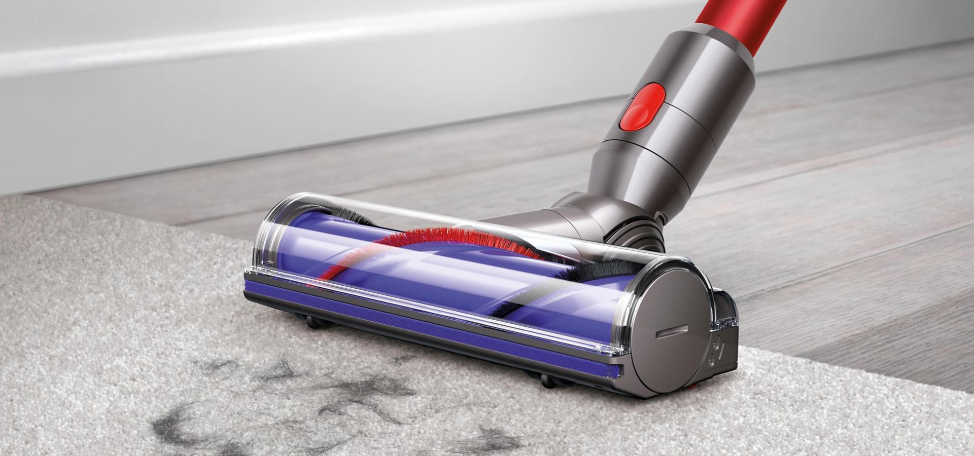 Dyson V7 direct crive cleaner head cleaning across carpet and hard floor