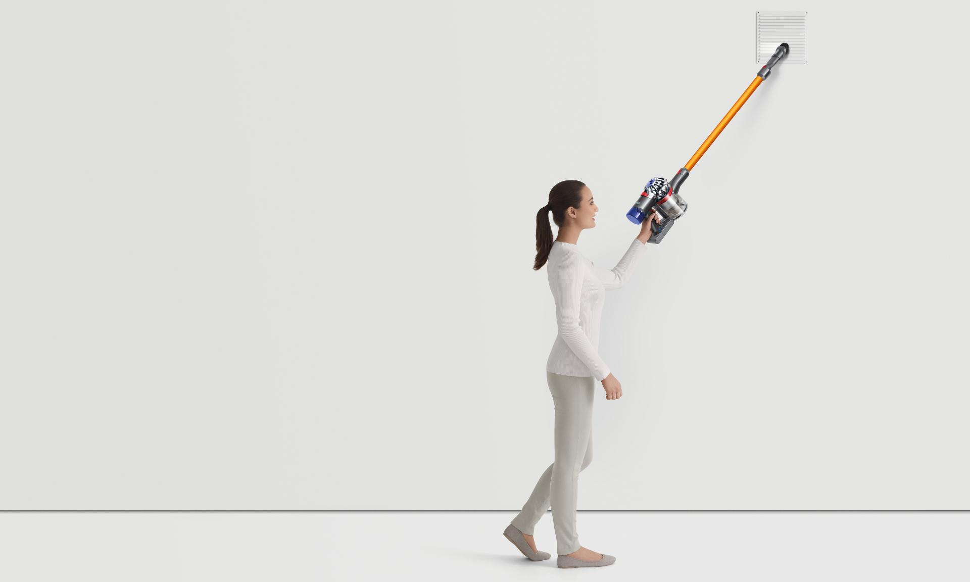 Woman cleaning with the Dyson V8 vacuum cleaner in a variety of scenarios
