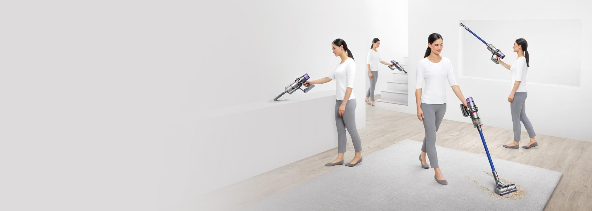 Woman cleaning the house with different Dyson vacuum accessories