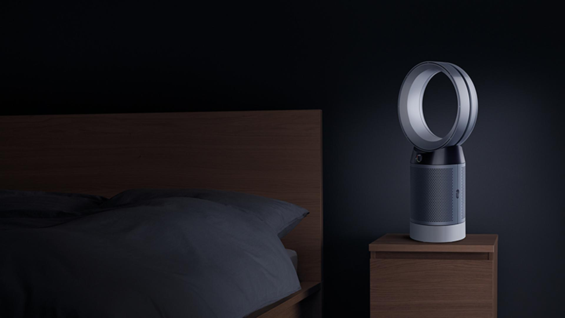 Desk purifier beside bed at night