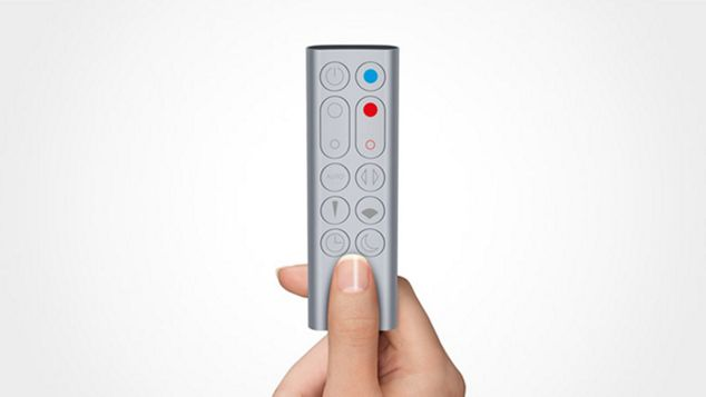 A hand holding Pure Hot+Cool Link™ remote control