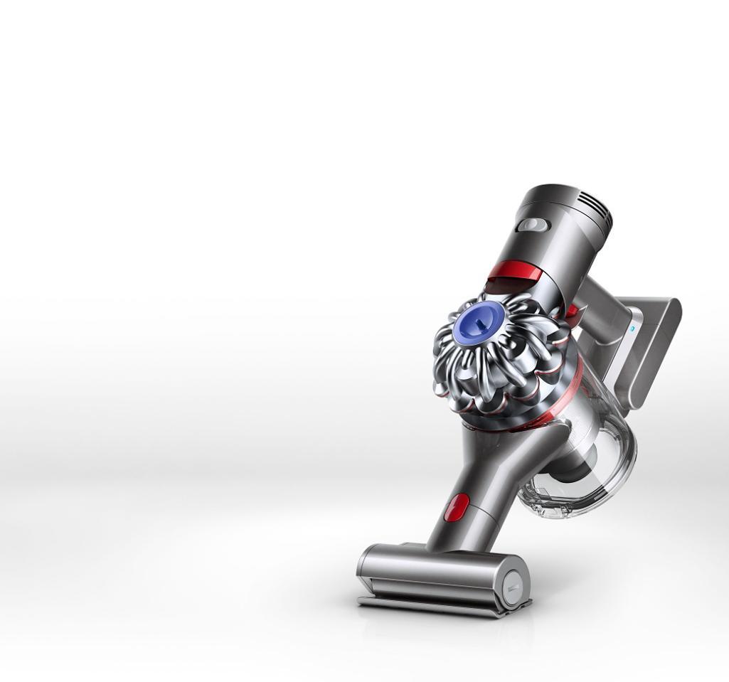 Dyson V7TM Handheld Vacuum On Upholstery