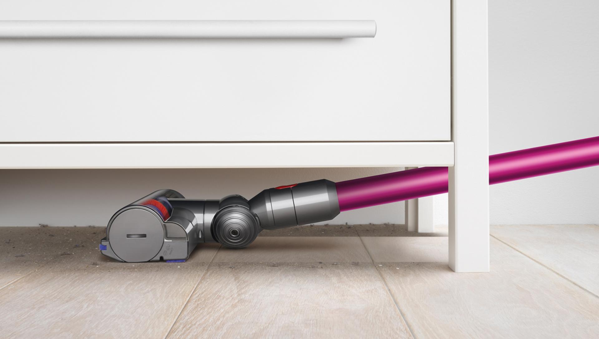 Dyson vacuum beneath furniture