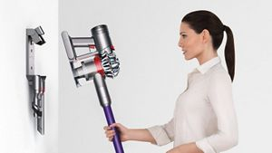 Model with Dyson wall-mounted dock