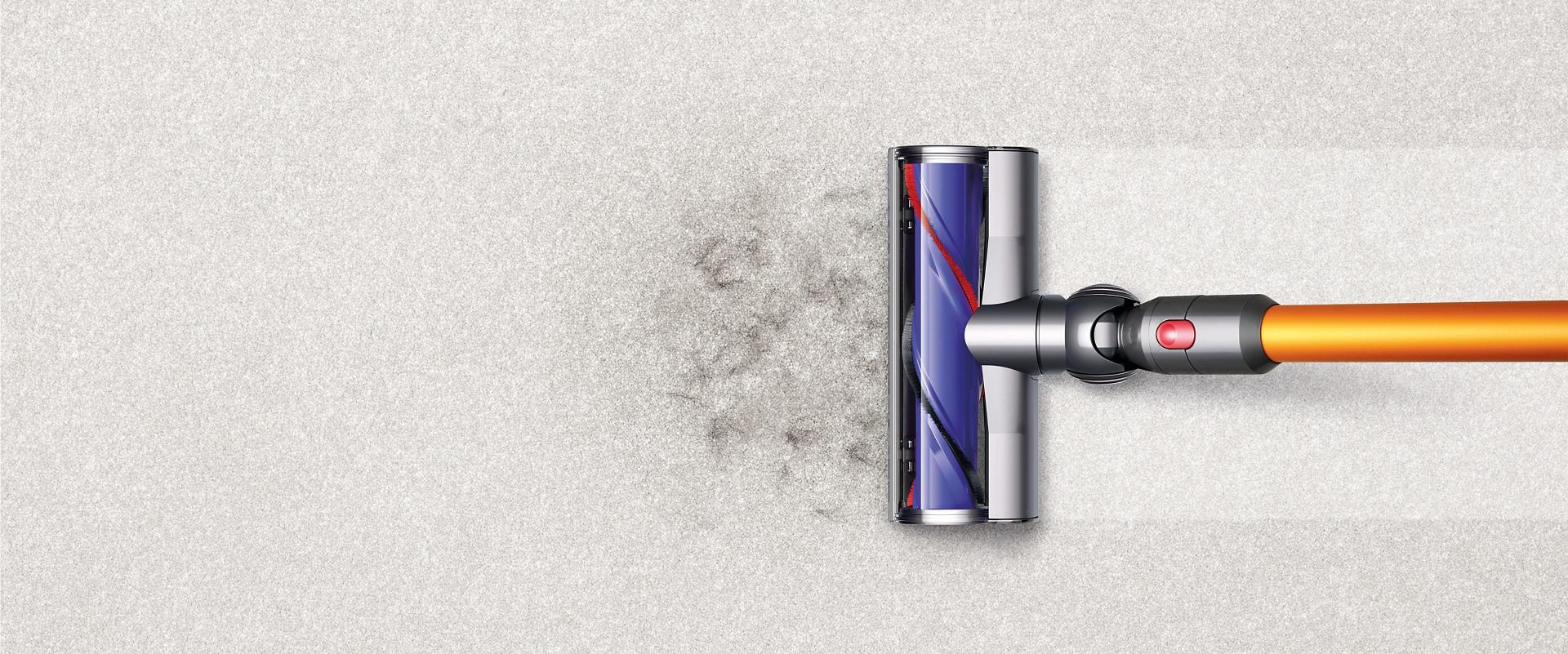 Dyson V8 cleaner head picking up debris from carpet