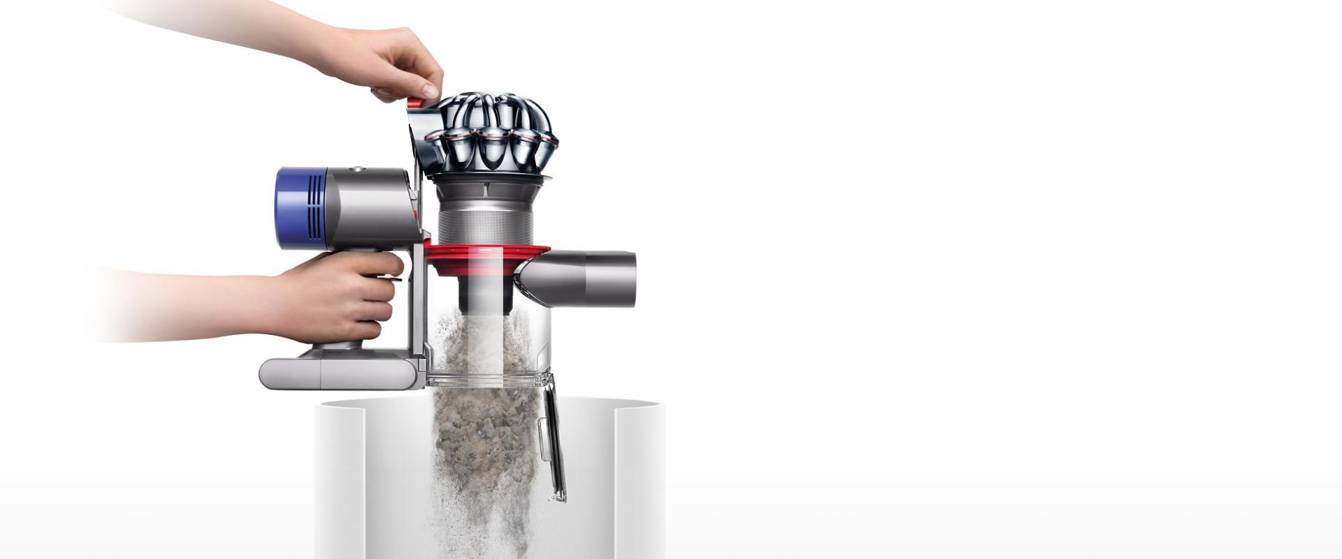 Dyson V8 being hygienically and easily emptied into a bin