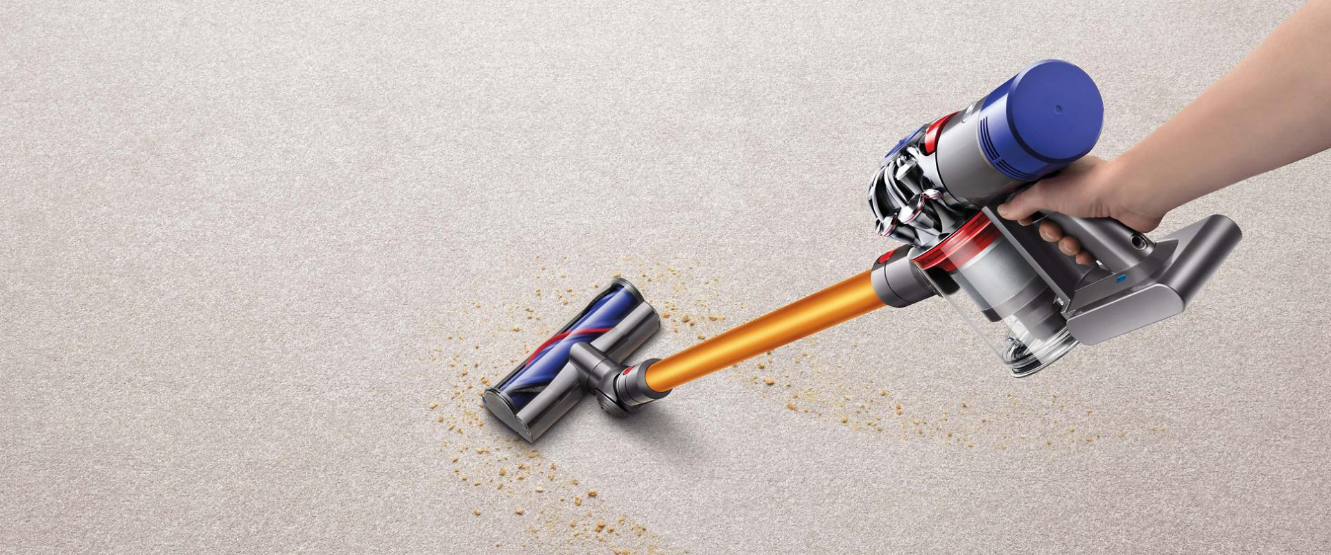 Dyson V8 vacuum cleaner picking up debris from carpet
