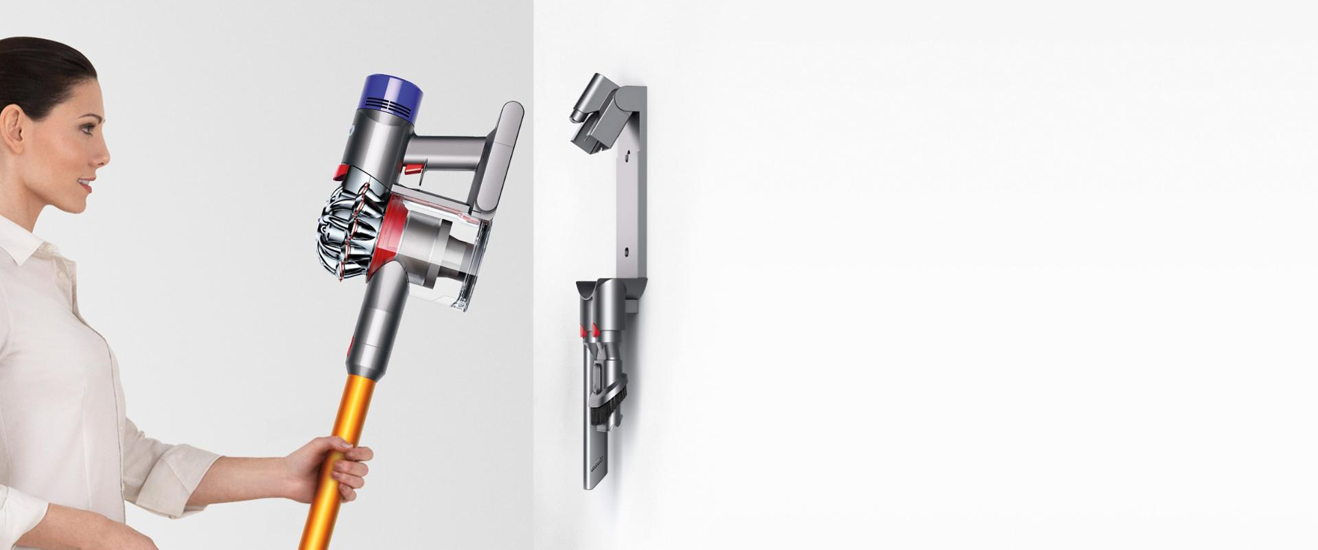 Dyson V8 being placed into wall mounted bracket