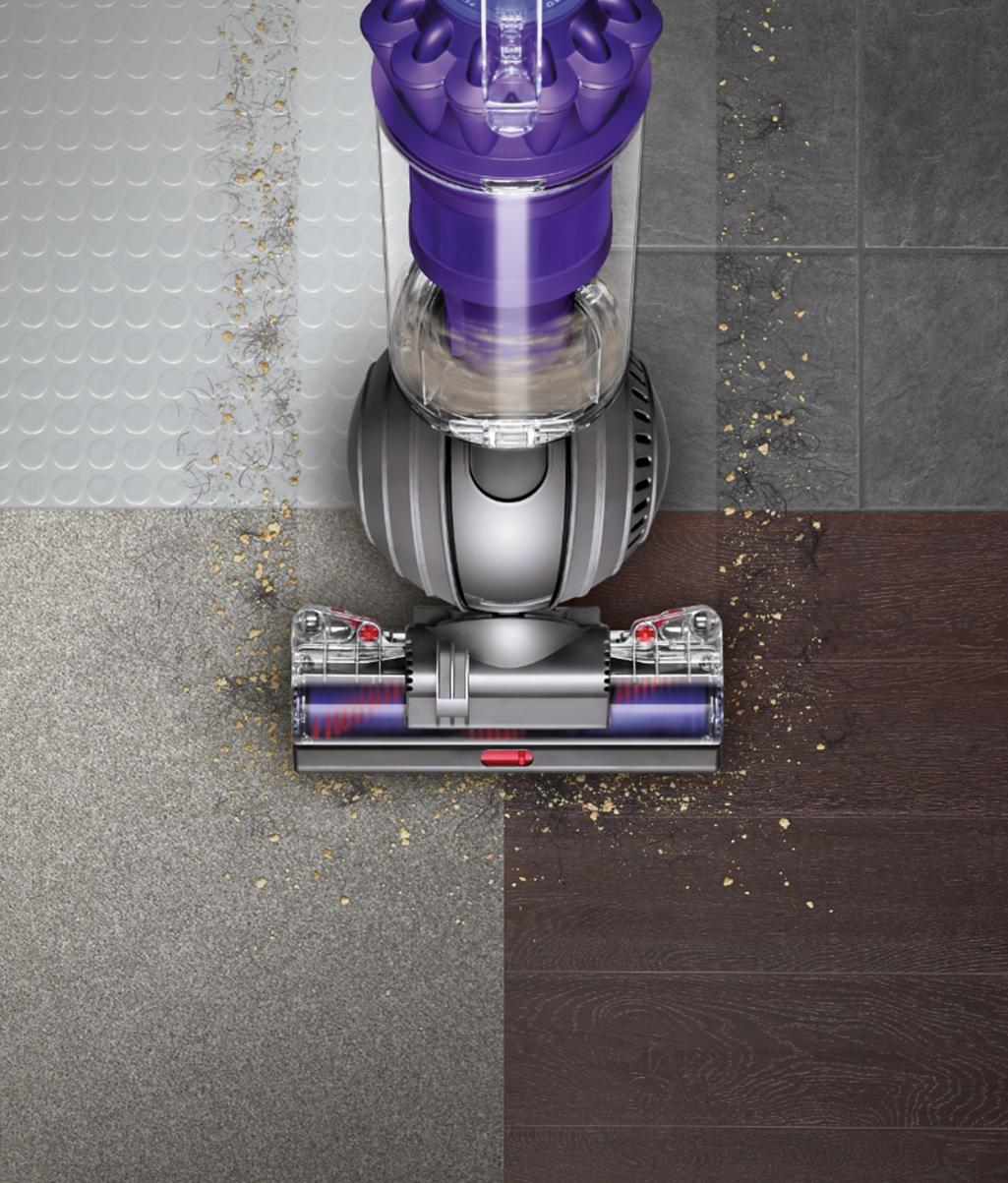 Dyson ball upright vacuum cleaner picking up debris across different floor  types