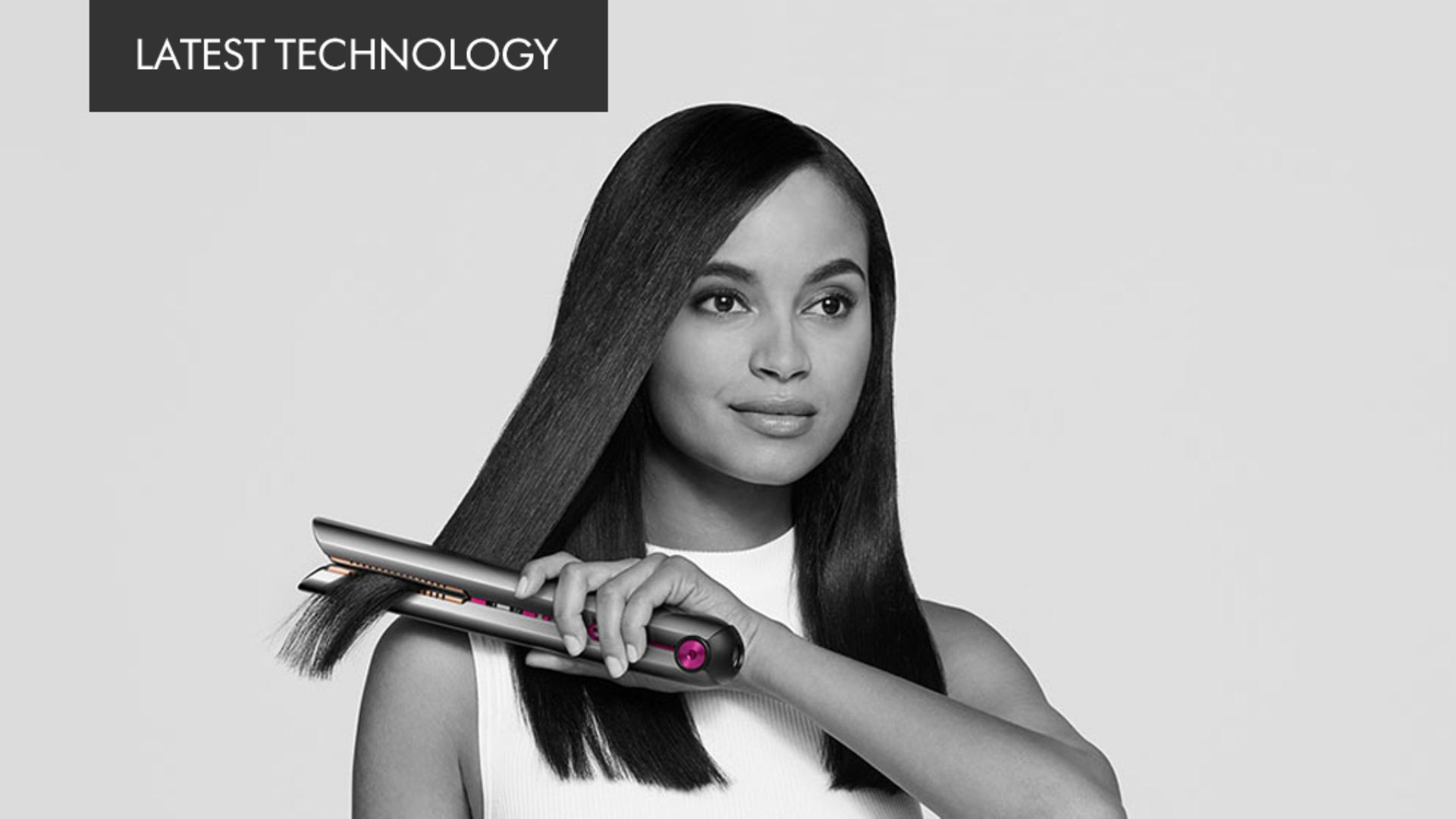 A model using the Dyson Corrale straightener