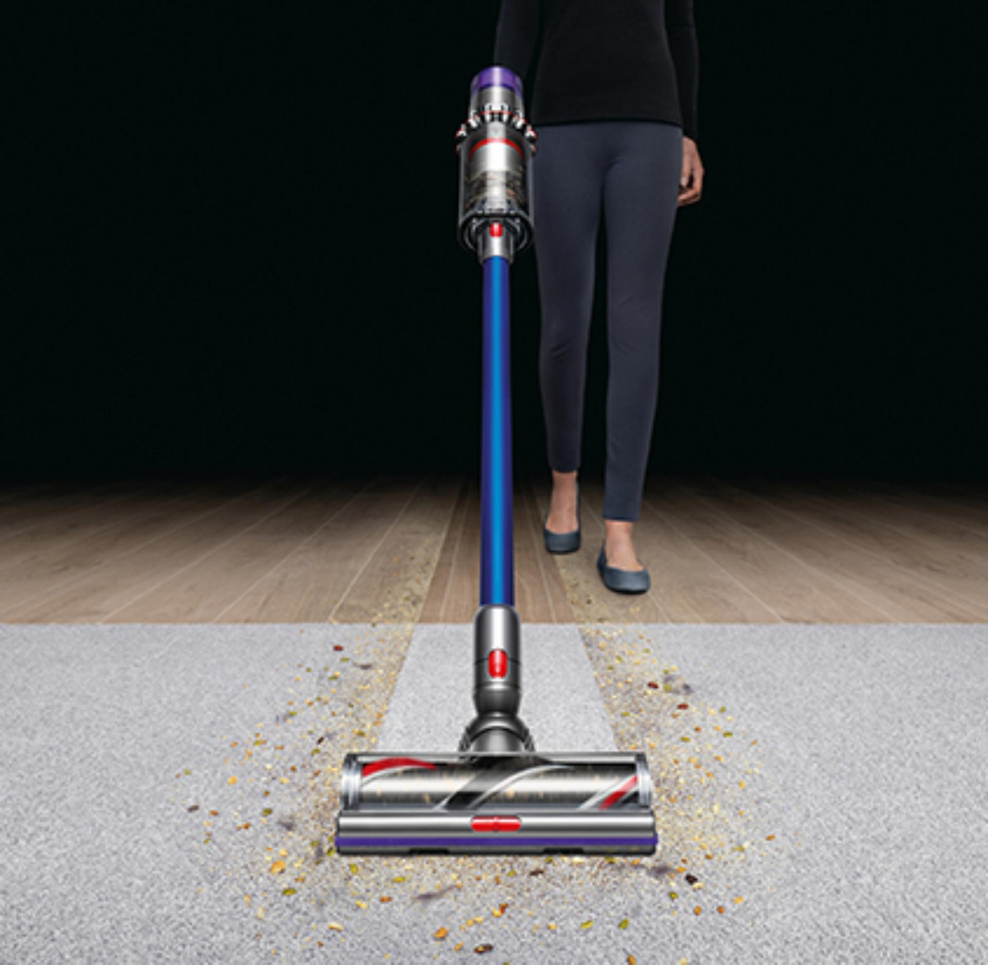 Dyson vacuum cleaner cleaning carpet