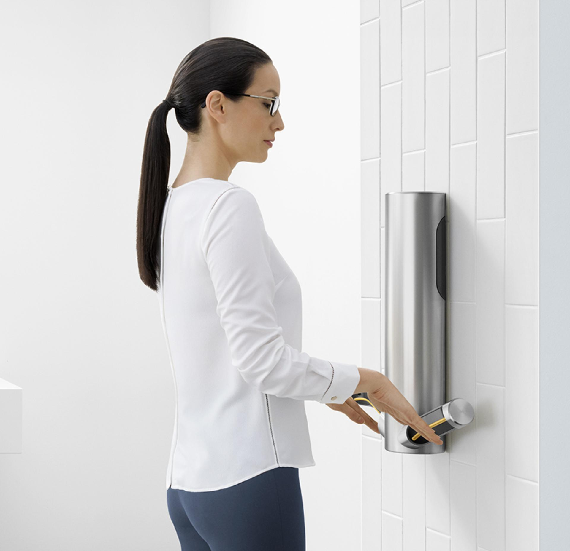 Woman drying hands