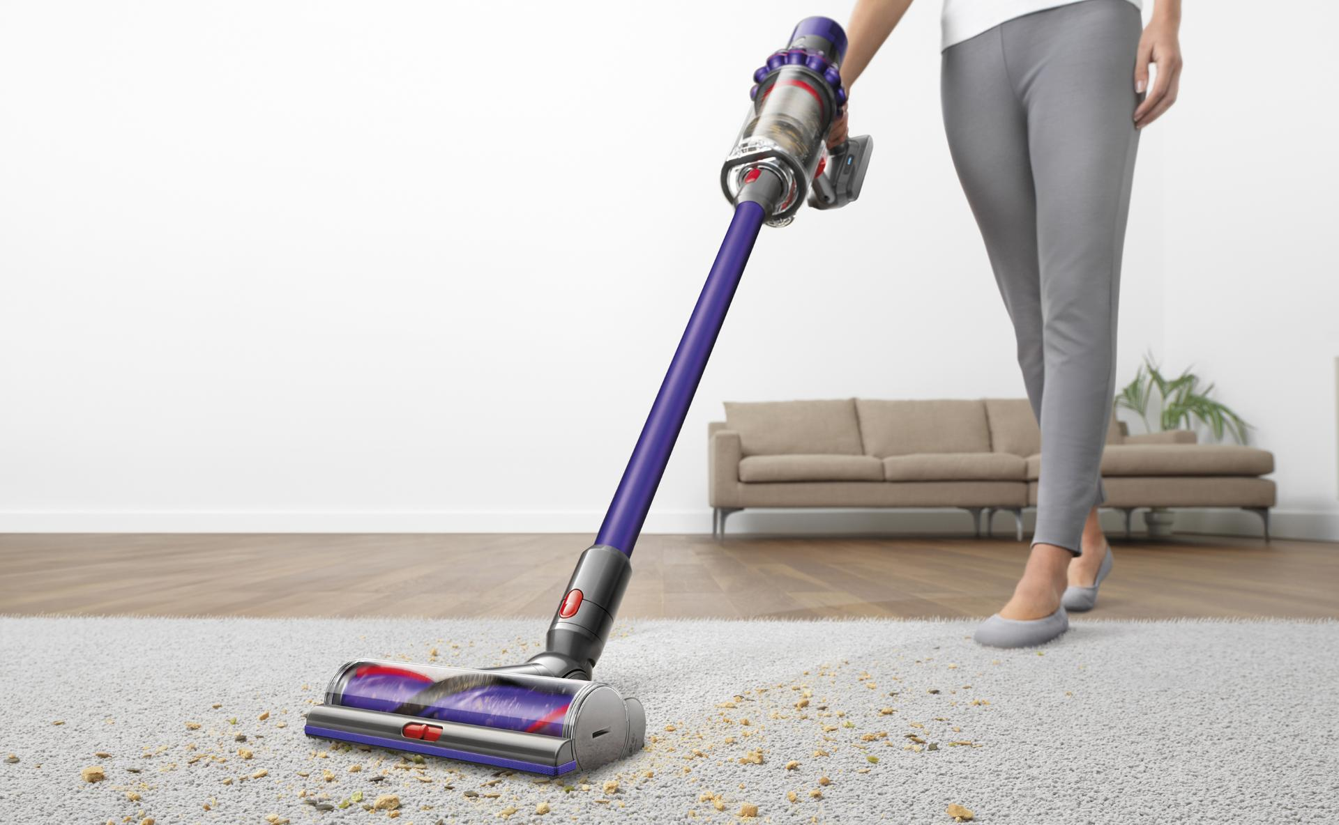 Woman using Dyson vacuum cleaner