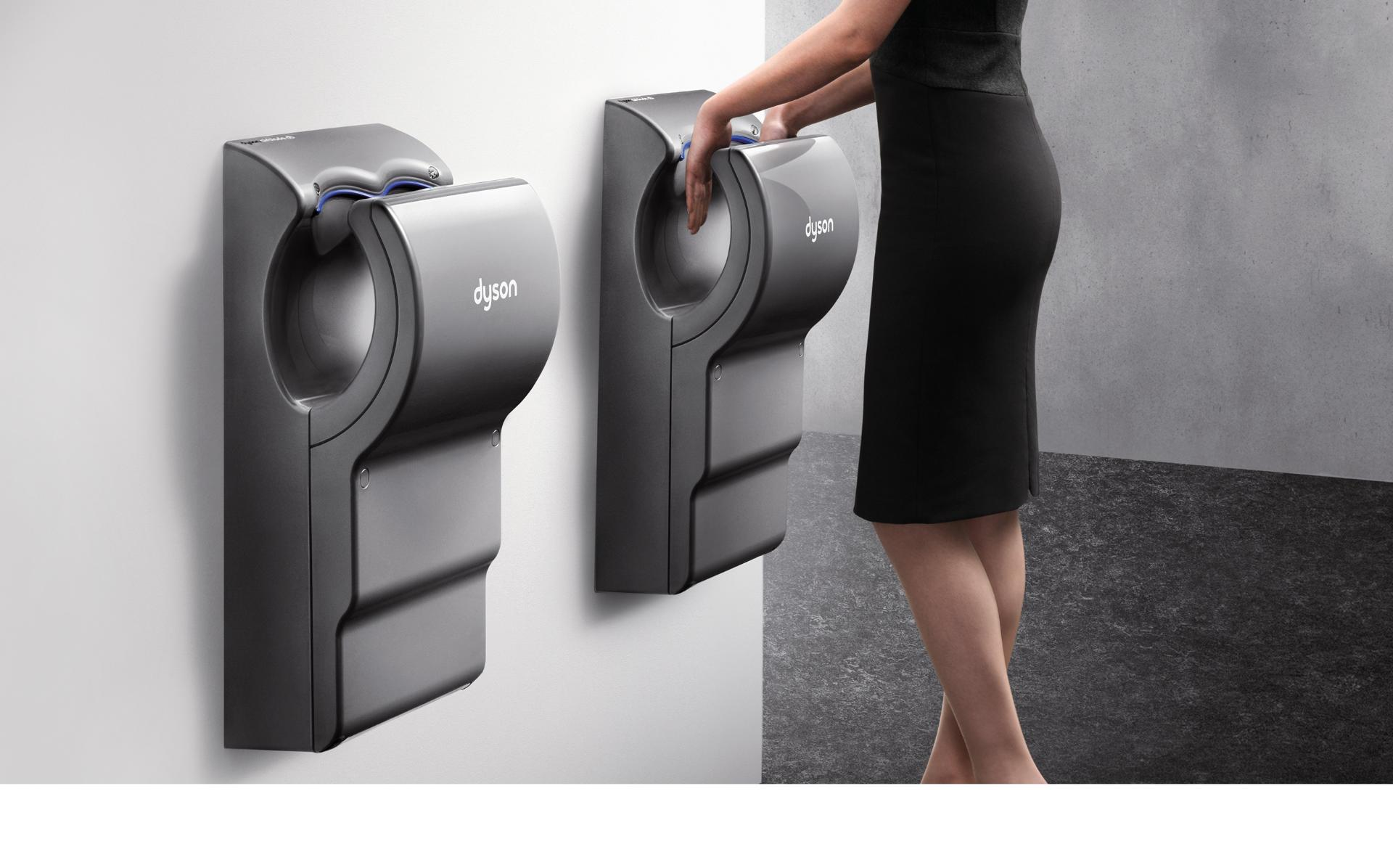 Hands being dried under Dyson Airblade dB hand dryer