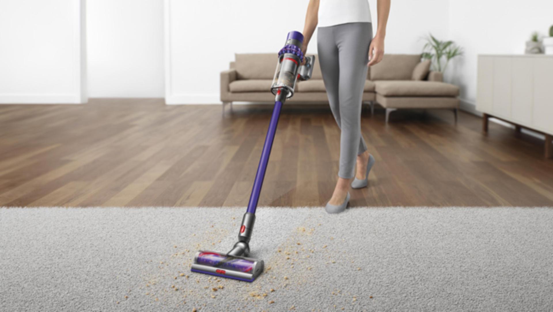 Dyson V10 vacuuming up dirt