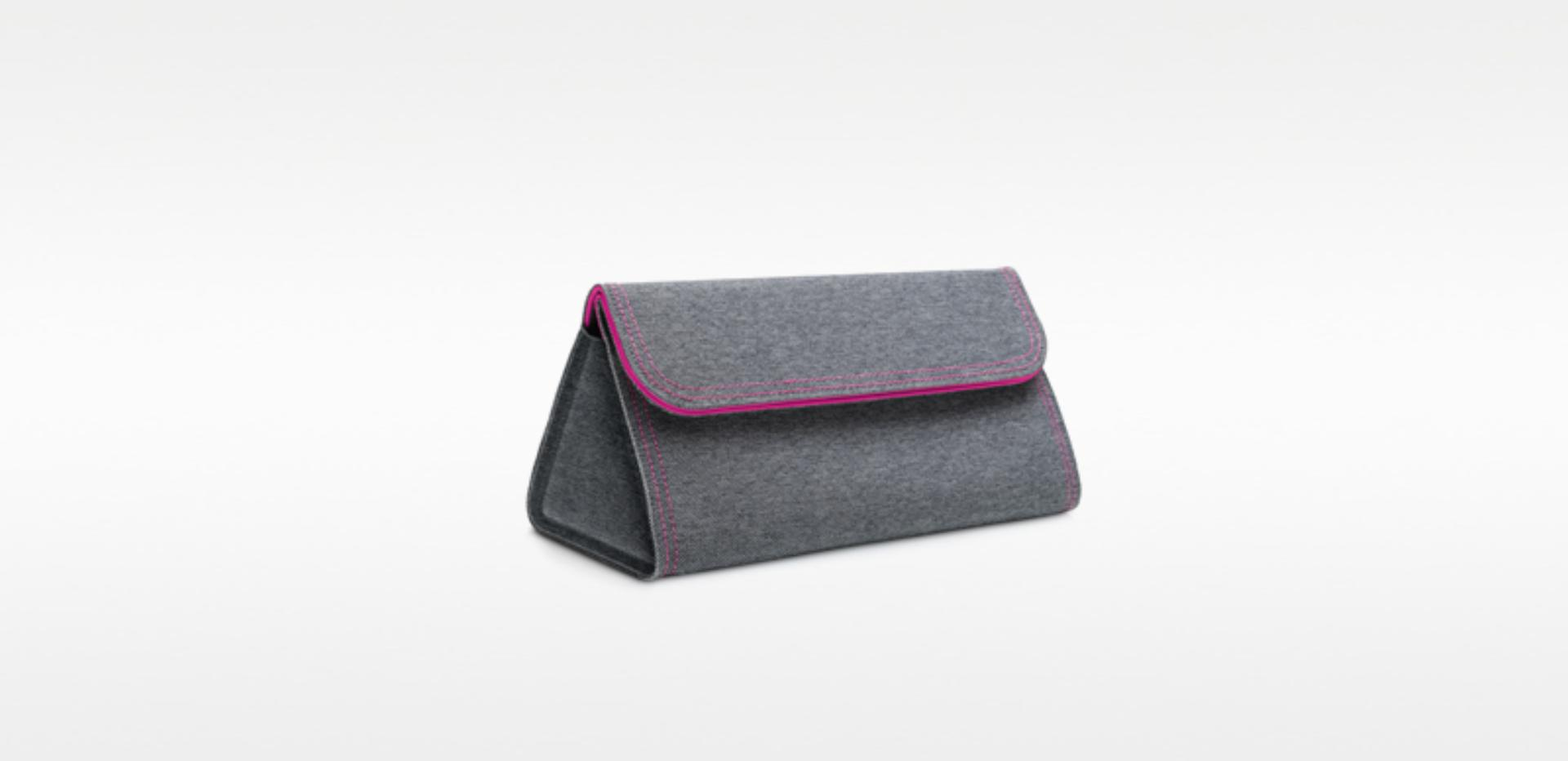 Woven storage bag stitched in fuchsia for the Dyson Supersonic™