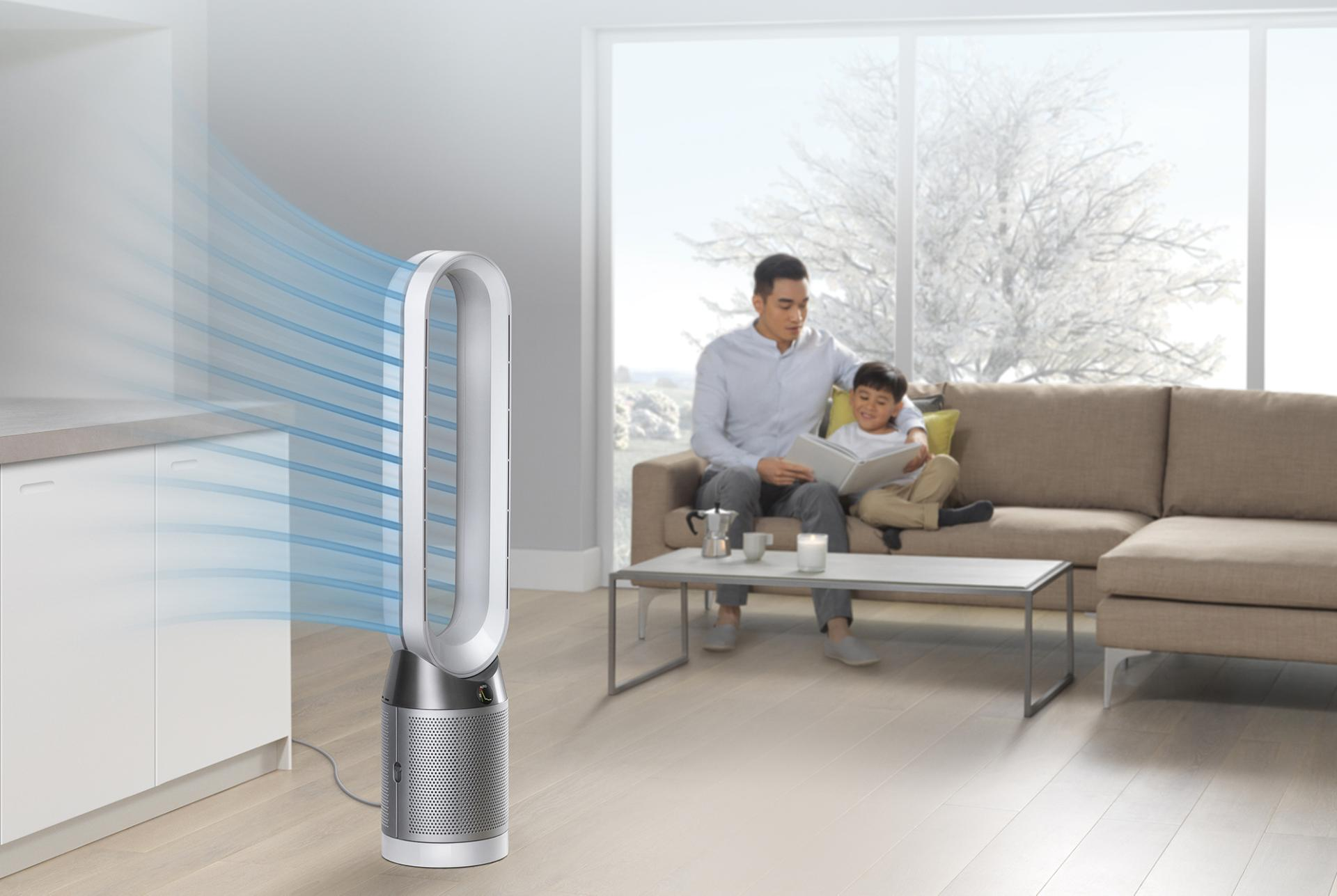 Man reading to son beside Dyson Pure Cool™ purifying fan