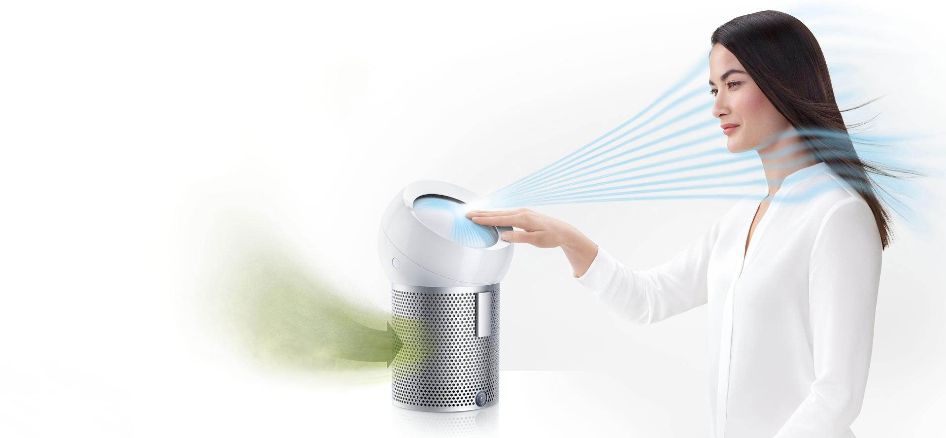 A woman using the Dyson Pure Cool Me personal purifier fan to project cooling, purified air