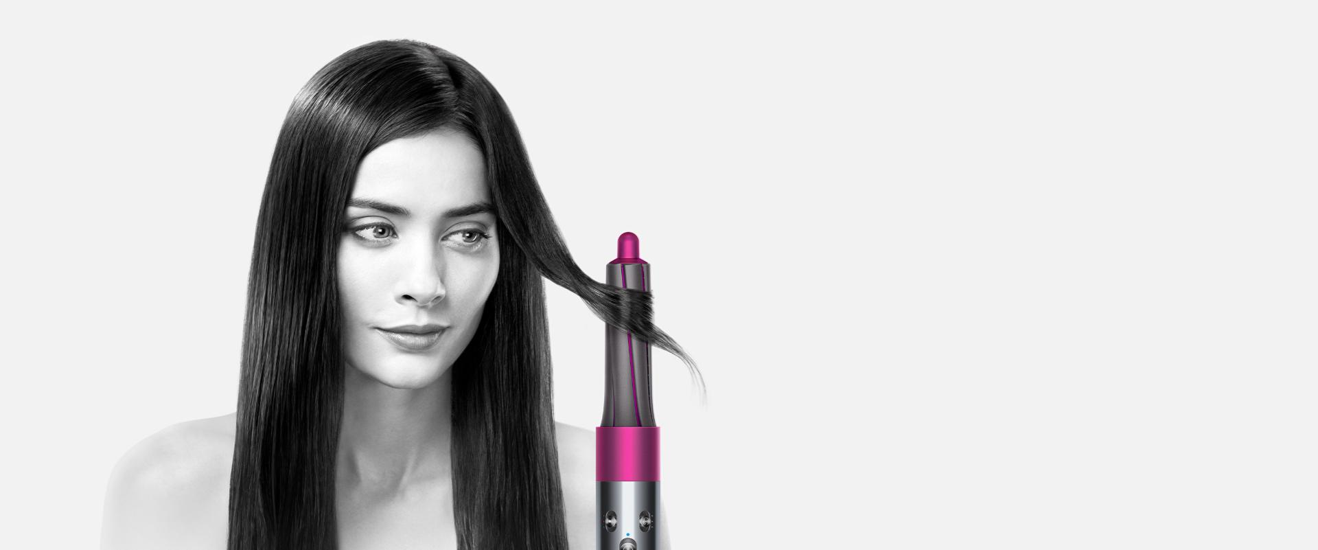 Model demonstrating the Dyson Airwrap™ hair styler on straight hair