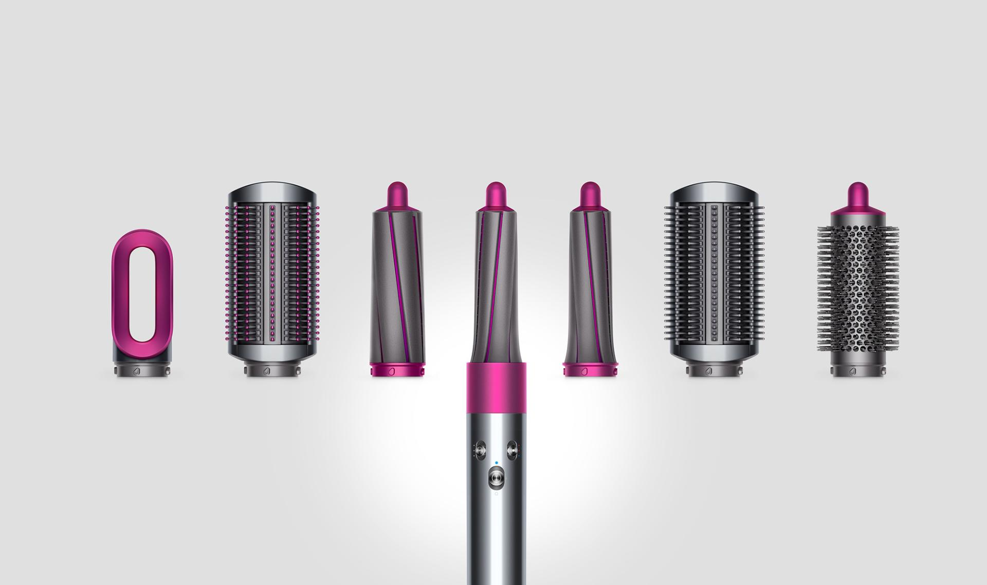 Dyson airwrap styler attachments being displayed in a line