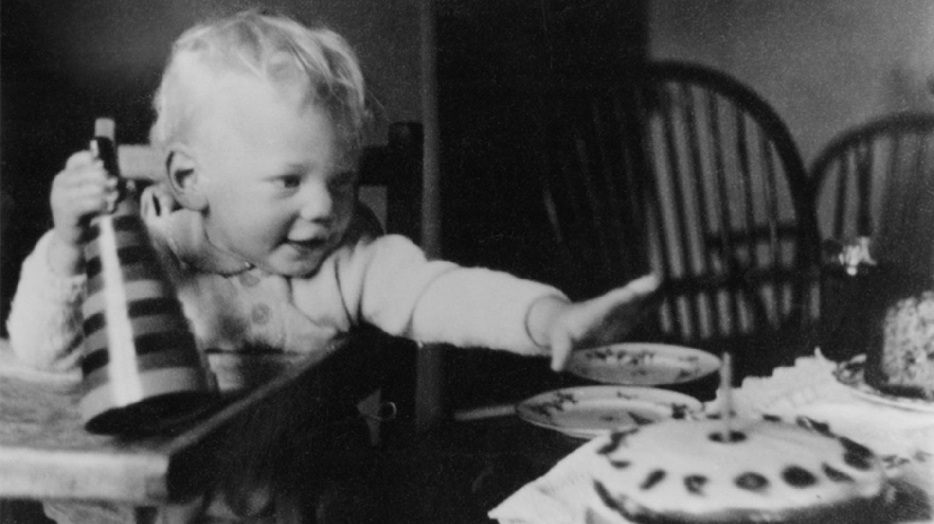 James Dyson on his first birthday reaching for his birthday cake