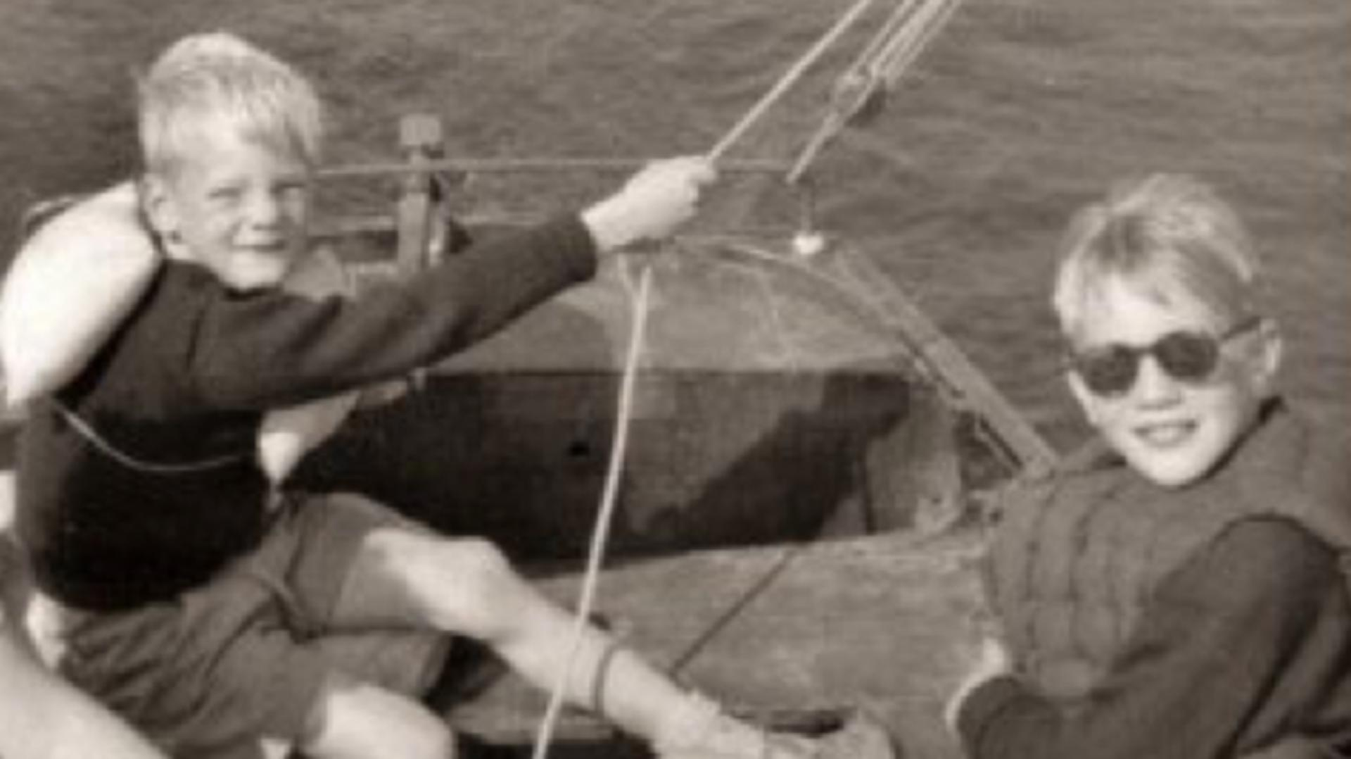 James Dyson and Tom Dyson sitting in a small sailing boat