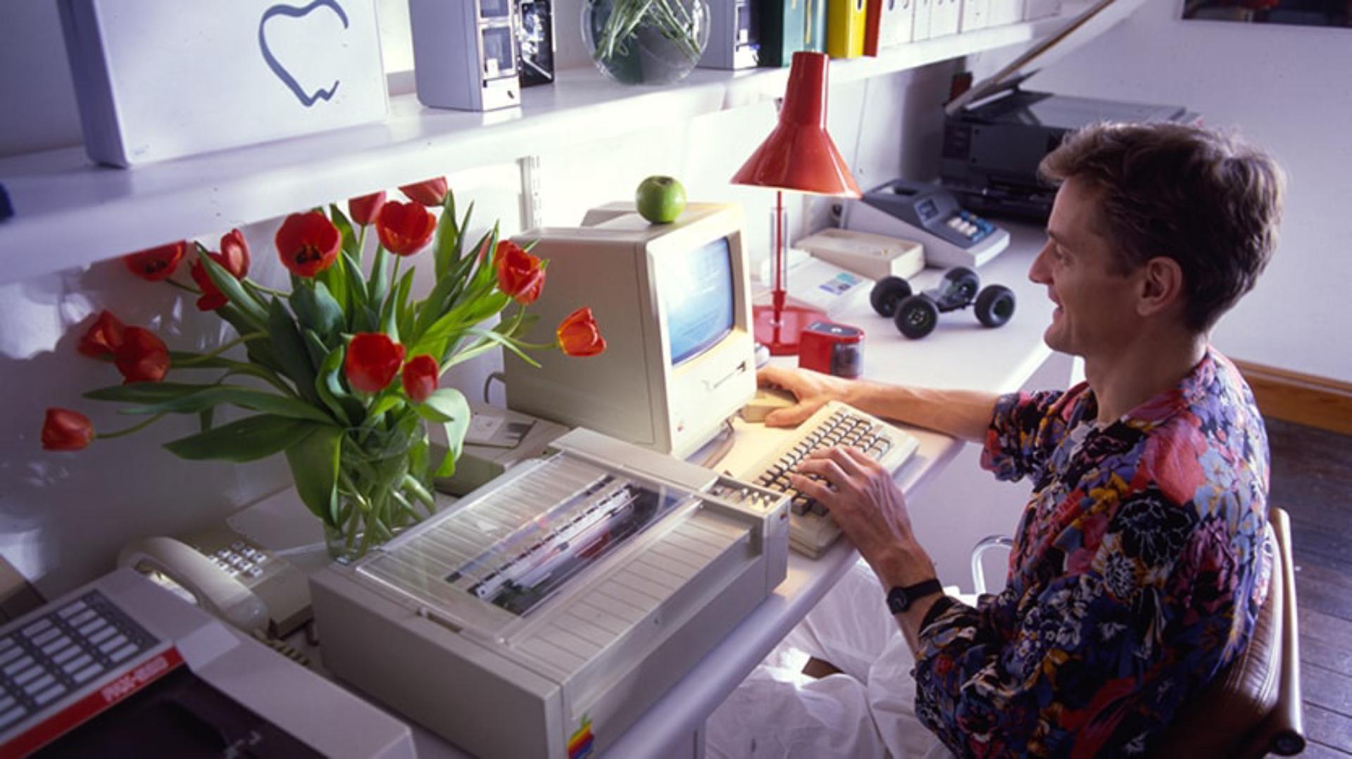 James Dyson working in front of desktop computer in Japan