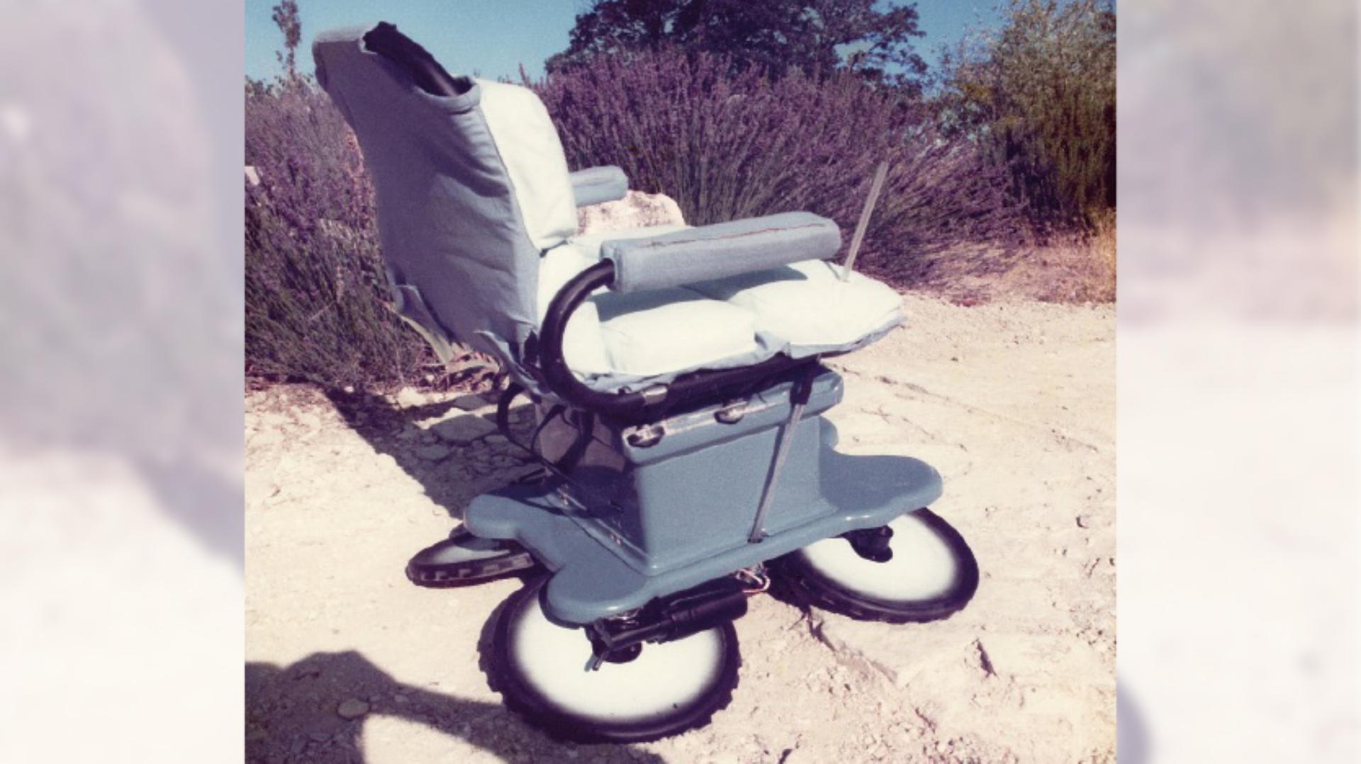 A large wheeled wheelchair