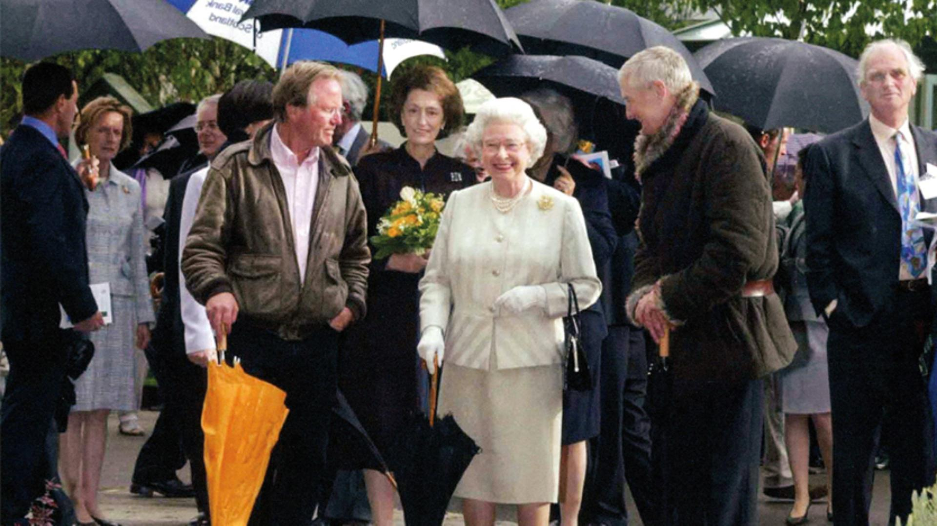 Queen Elizabeth II at The Chelsea Flower Show with James Dyson and Charles Moore