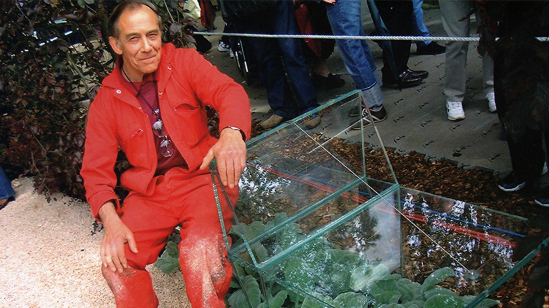 Derek Phillips sitting on an 'impossible' glass bench