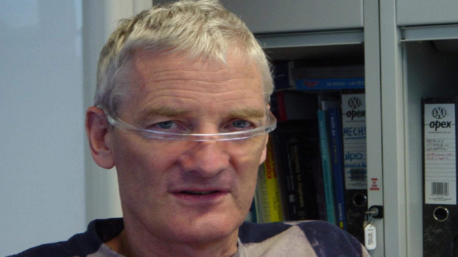 Close up portrait photo of James Dyson wearing the Halo prototype