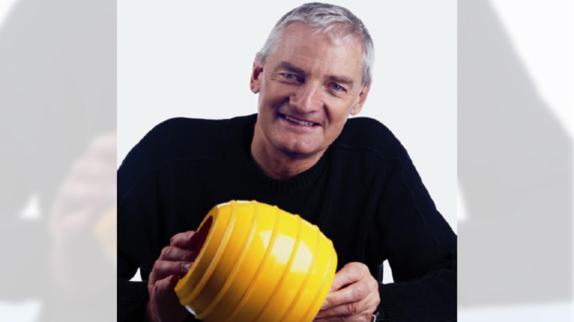Close up James Dyson photo, with James holding a ball from the Ballbarrow design