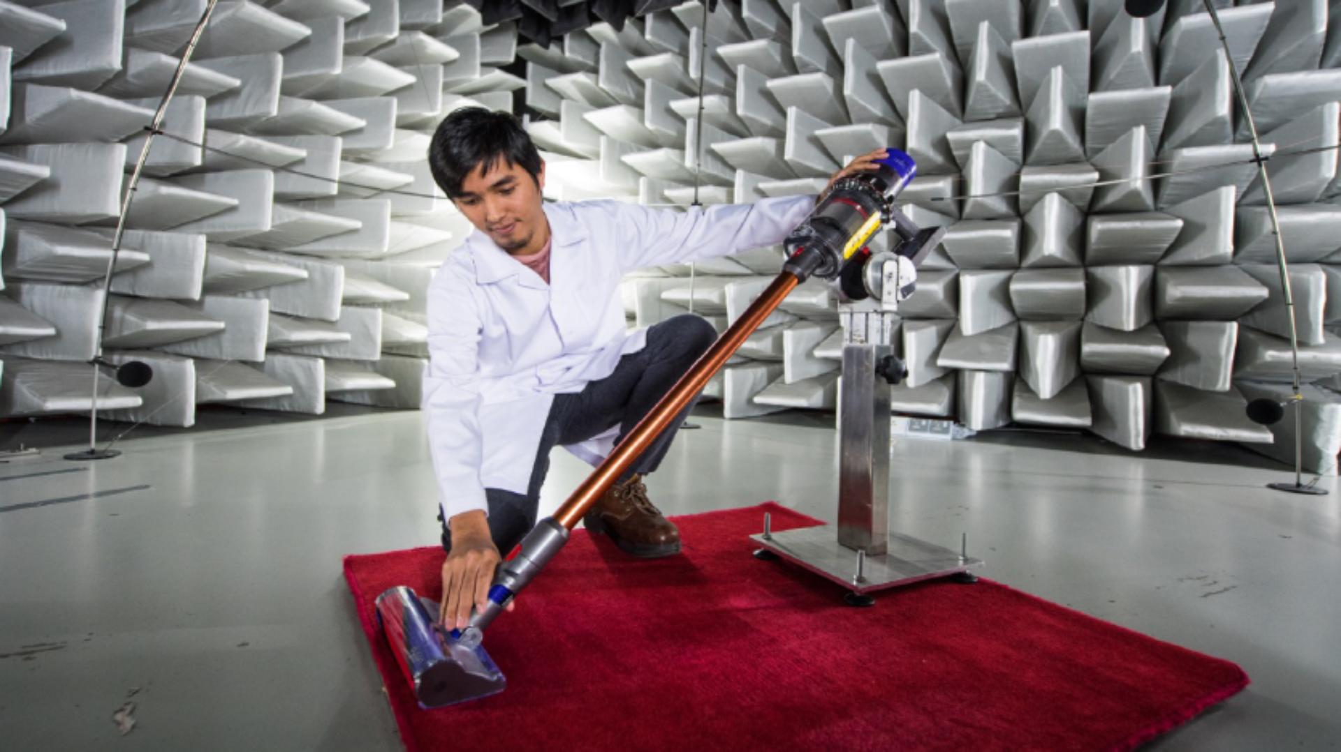 A lab engineer tests a Dyson V15 in a semi anechoic chamber in Malaysia