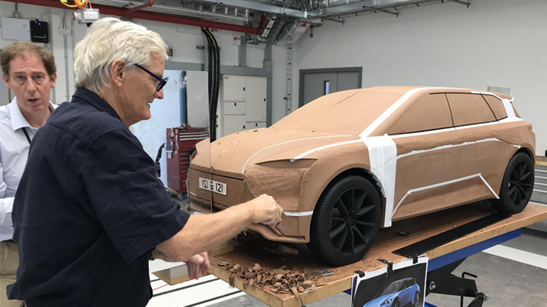 James Dyson with a scale clay model of the electric car